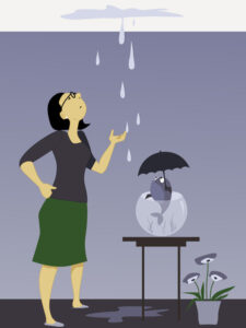 woman looking at a dripping leak on the ceiling, fish in a bowl holding an umbrella